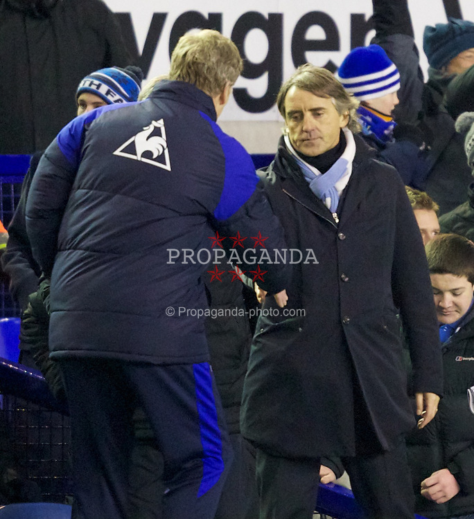 LIVERPOOL, ENGLAND - Tuesday, January 31, 2012: Manchester City's manager Roberto Mancini looks dejected as he walks over to Everton's manager David Moyes after the Premiership match at Goodison Park. (Pic by Vegard Grott/Propaganda)