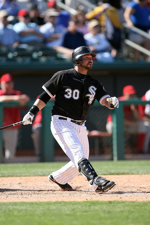 TUCSON - MARCH 4:  Nick Swisher #30 of the Chicago White Sox hits a double during the game against the Los Angeles Angels at Tucson Electric Park in Tucson Arizona on March 4, 2008.  The White Sox defeated the Angels 7-6.  (Photo by Ron Vesely)