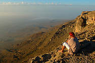 Omani man Mustafa on Jebel Samhan,  view over plain of Mirbat,  near Salalah, Dhofar, Oman, Arabian Peninsula