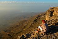 Omani man Mustafa on Jebel Samhan,  view over plain of Mirbat,  near Salalah, Dhofar, Oman, Arabian Peninsula