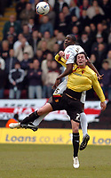 Photo: Leigh Quinnell.<br /> Watford v Luton Town. Coca Cola Championship. 09/04/2006. Watfords Chris Eagles jumps with Lutons Leon Barnett.