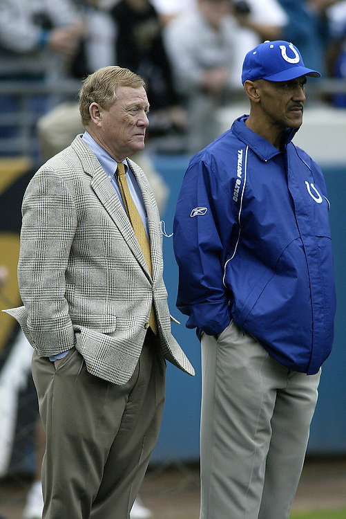 Head Coach Tony Dungy of the Indianapolis Colts  stands beside General  Manager Bill Polian before their  28-23 defeat to the Jacksonville Jaguars on 11/09/2003. ©JC Ridley/NFL Photos.