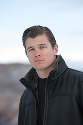 portrait of a handsome All American man in a leather jacket outdoors