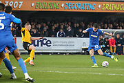 AFC Wimbledon midfielder Callum Reilly (33) with a shot on goal during the EFL Sky Bet League 1 match between AFC Wimbledon and Southend United at the Cherry Red Records Stadium, Kingston, England on 1 January 2020.
