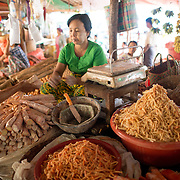 NYAUNG-U, Myanmar - A woman sells roots and vegetables at Nyaung-U Market, near Bagan, Myanmar (Burma).