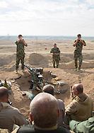 Iraq, Kurdistan, Kirkuk, kurdish peshmergas on the frontline taking photos souvenirs