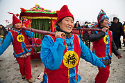 Entertainers at the traditional Ma Jie storytelling festival in Henan province, China.<br /> <br /> Farmers in Henan have for centuries gathered during the Chinese New Year in the wheat fields to listen to bards singing and recounting old tales. <br /> <br /> Performers come from all over China. Those who are successful will be booked during the festival to perform in nearby villages. <br /> <br /> The stories are usually accompanied by music, played by the storyteller or by a musician.