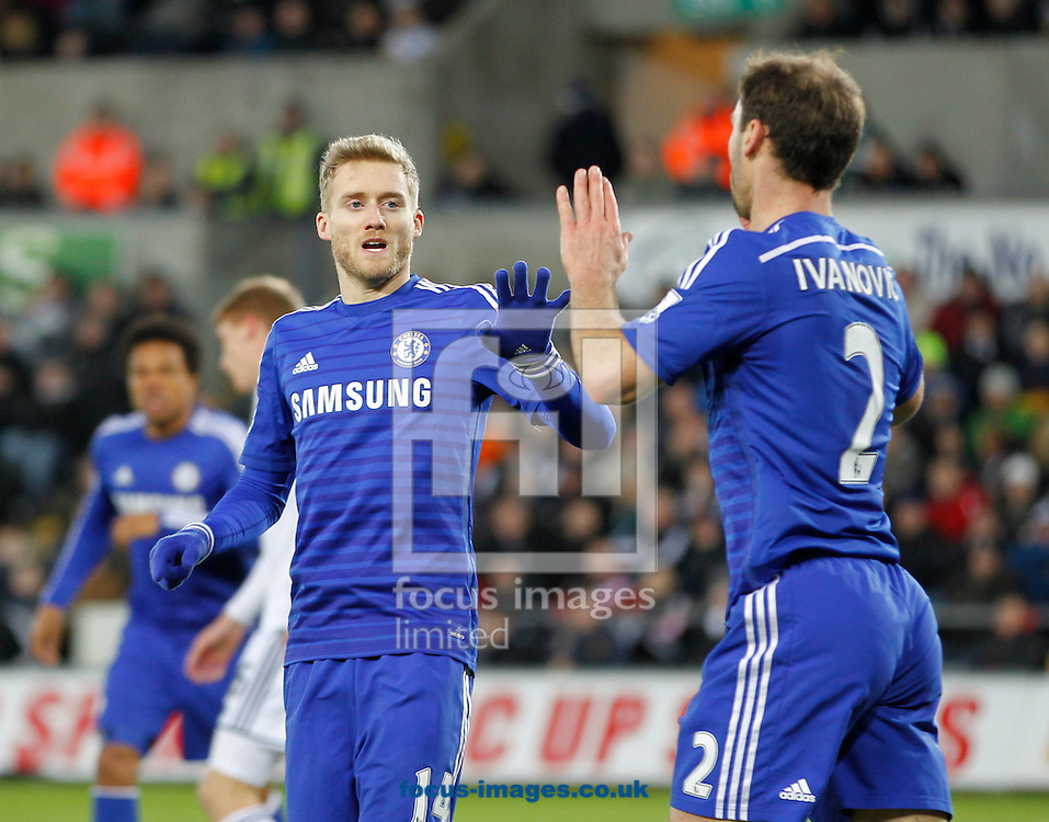 Andre Schurrle (L) of Chelsea celebrates the fifth goal during the Barclays Premier League match at the Liberty Stadium, Swansea<br /> Picture by Mike Griffiths/Focus Images Ltd +44 7766 223933<br /> 17/01/2015