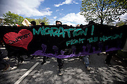 Hamburg | 01 May 2015<br /> <br /> 4000 protesters take part in the &quot;Never Mind The Papers&quot; rally for migrants and refugees in the german city of Hamburg. Picture shows a banner wich reads &quot;Migration! Fight The Nation&quot;.<br /> <br /> &copy;peter-juelich.com<br /> <br /> [Foto honorarpflichtig | Fees Apply | No Model Release | No Property Release]