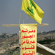 16th Augudt 2006&#xA;Bazuriyah, Lebanon&#xA;Nazrullah's former home.&#xA;During the previous civil conflict Hassan Nasrallah, then a young man moved from Beirut to Bazuriyah in southern Lebanon. Areas of this town were badly damaged during recent Israeli airstrikes and a Hezbollah flag now flies amidst the ruins. A cousin of Nasrullah and his daughter whose home was also damaged walk through the debris.<br />