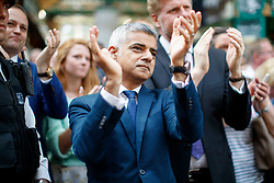 © Licensed to London News Pictures. 14/06/2017. London, UK. Mayor of London SADIQ KHAN attends the reopening of Borough Market in London as it reopens on 14 June 2017, following a terror attack that killed 8 people over a week ago. Photo credit: Tolga Akmen/LNP