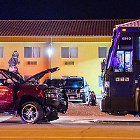 080114       Cable Hoover<br /> <br /> Passengers and other bystanders watch as Gallup Police investigate the scene of a head-on collision between a pickup and Greyhound bus on Historic Higway 66 in Gallup Friday.
