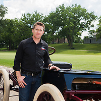NASCAR driver Carl Edwards standing by Henry Ford's first race car Sweepstakes. Photographed for Ford Racing by Public Relations Photographer KMS Photography.