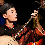 Musician plays traditional Vietnamese guitar (Hanoi, Vietnam - Nov. 2008) (Image ID: 081113-1449501a)