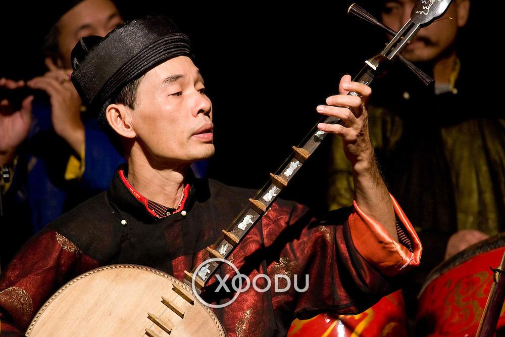Musician plays traditional Vietnamese guitar (Hanoi, Vietnam - Nov. 2008) (Image ID: 081113-1449501a)