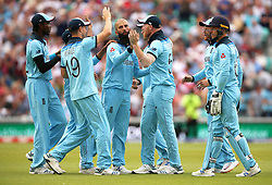 England team-mates celebrate the wicket of South Africa's JP Duminy (not pictured) during the ICC Cricket World Cup group stage match at The Oval, London.