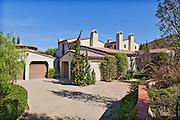 View up driveway to luxury villa