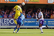 Shrewsbury Town goalkeeper Max O'Leary (25) beating AFC Wimbledon attacker Marcus Forss (15) to the ball and heading it away during the EFL Sky Bet League 1 match between AFC Wimbledon and Shrewsbury Town at the Cherry Red Records Stadium, Kingston, England on 14 September 2019.