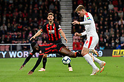 Jefferson Lerma (8) of AFC Bournemouth is fouled by Alexander Sorloth (9) of Crystal Palace during the Premier League match between Bournemouth and Crystal Palace at the Vitality Stadium, Bournemouth, England on 1 October 2018.