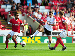 Bristol City's Sam Baldock tries squeeze between Barnsley's Scott Golbourne and Barnsley's Scott Wiseman  - Photo mandatory by-line: Joe Meredith/Josephmeredith.com  - Tel: Mobile:07966 386802 01/09/2012 - Barnsley v Bristol City - SPORT - FOOTBALL - Championship -  Barnsley  - Oakwell Stadium -