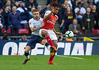 Football - 2018 / 2019 Premier League - Tottenham Hotspur vs. Arsenal<br /> <br /> Alex Iwobi (Arsenal FC) protects the ball from Kieran Trippier (Tottenham FC) at Wembley Stadium.<br /> <br /> COLORSPORT/DANIEL BEARHAM