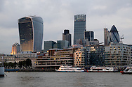 The modern London, England skyline above the Thames River