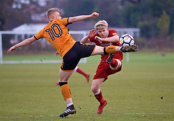 WOLVERHAMPTON, ENGLAND - Tuesday, December 19, 2017: Liverpool's Edvard Sandvik Tagseth and Wolverhampton Wanderer's Taylor Perry during an Under-18 FA Premier League match between Wolverhampton Wanderers and Liverpool FC at the Sir Jack Hayward Training Ground. (Pic by David Rawcliffe/Propaganda)