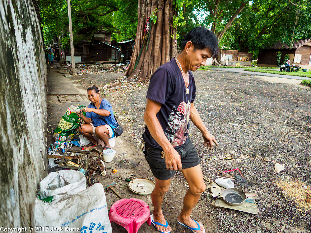 07 JUNE 2017 - BANGKOK, THAILAND:  People who scavenge recyclable materials out of old homes in Pom Mahakan sort through their take. Bangkok city officials are expected to tear the structure down in coming weeks. The final evictions of the remaining families in Pom Mahakan, a slum community in a 19th century fort in Bangkok, have started. City officials are moving the residents out of the fort. NGOs and historic preservation organizations protested the city's action but city officials did not relent and started evicting the remaining families in early March.         PHOTO BY JACK KURTZ