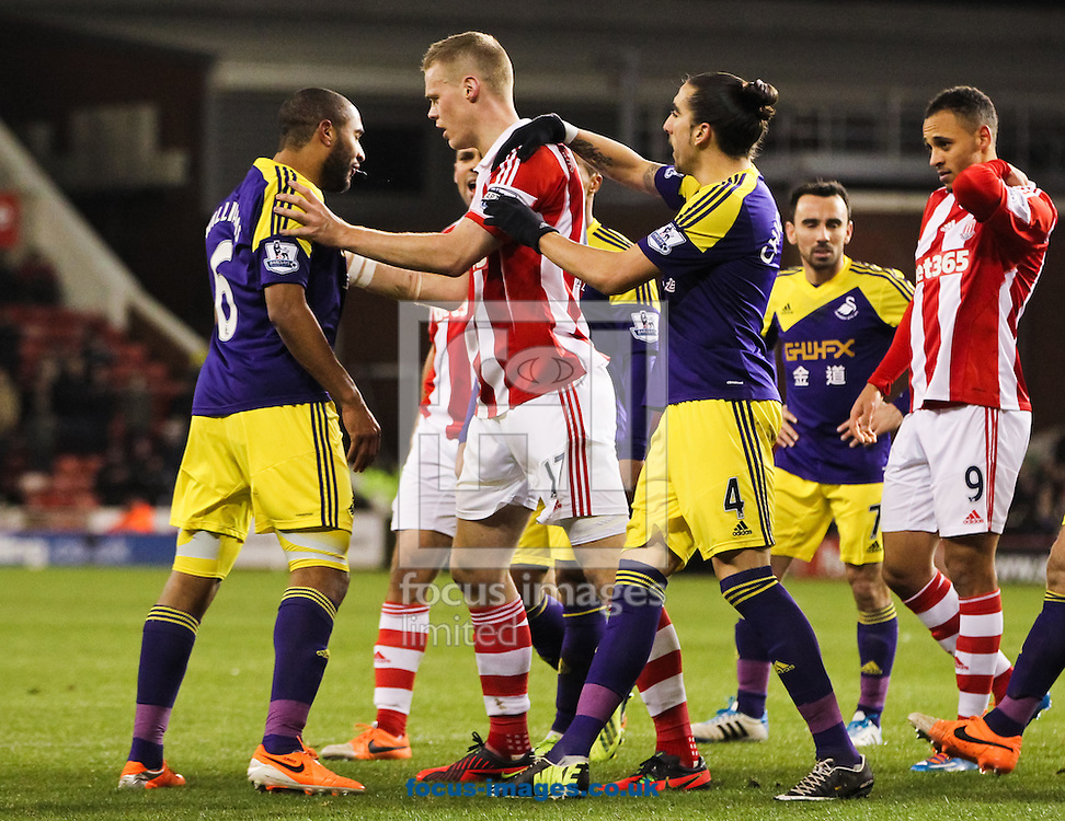 Ryan Shawcross (3rd left) of Stoke City pushes Ashley Williams (left) of Swansea City as Chico (3rd right) tries to break them up during the Barclays Premier League match at the Britannia Stadium, Stoke-on-Trent<br /> Picture by Tom Smith/Focus Images Ltd 07545141164<br /> 12/02/2014