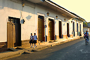 In the early morning, Nicaraguan children walk to school on the Spanish colonial styled streets of Leon, Nicaragua.