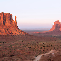 Sunset shadow of the west Mitten falls on the east Mitten during this September sunset. Monument Valley Navajo Tribal Park, Arizona