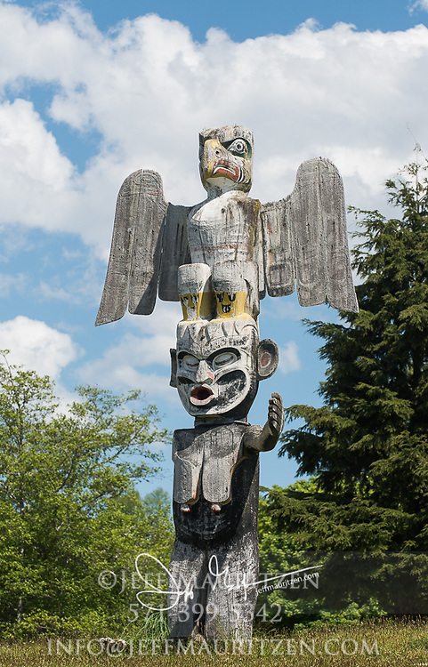 Totem pole of Thunderbird and Dzunukwa carved by Willie Seaweed in memorial of Billie Moon, located in the Namgis burial ground in Alert Bay, British Columbia, Canada.