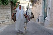 Israel, Jerusalem. A local Arab selling kerosene off of his donkey