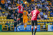 Mihai Popescu of St Mirren wins the ball ahead of Scott Robinson of Livingstone during the Ladbrokes Scottish Premiership match between Livingston and St Mirren at Tony Macaroni Arena, Livingstone, Scotland on 20 April 2019.