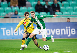 Marko Pajac #19 of NK Celje vs Miha Zajc #6 of NK Olimpija Ljubljana during football match between NK Olimpija Ljubljana and NK Celje in Round #25 of Prva liga Telekom Slovenije 2015/16, on March 13, 2016 in SRC Stozice, Ljubljana, Slovenia. Photo by Vid Ponikvar / Sportida