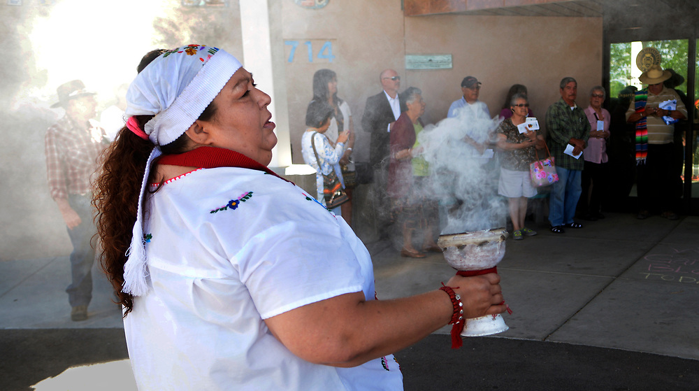 gbs051517b/ASEC -- Tonita Gonzales of Albuquerque uses copal incense during the 5th Annual El Camino Real Garden Blessing at the Barelas Senior Center onMonday, May 15, 2017.&nbsp; The tradition is over 400 years old and is celebrated in Spanish speaking countries around the world on the feast of San Isidro, patron of farmers and gardeners.(Greg Sorber/Albuquerque Journal)<br /> &nbsp;