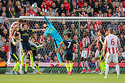 Arsenal goalkeeper Petr Cech tips the ball over the back of the crossbar during the Premier League match between Stoke City and Arsenal at the Bet365 Stadium, Stoke-on-Trent, England on 13 May 2017. Photo by Aaron  Lupton.