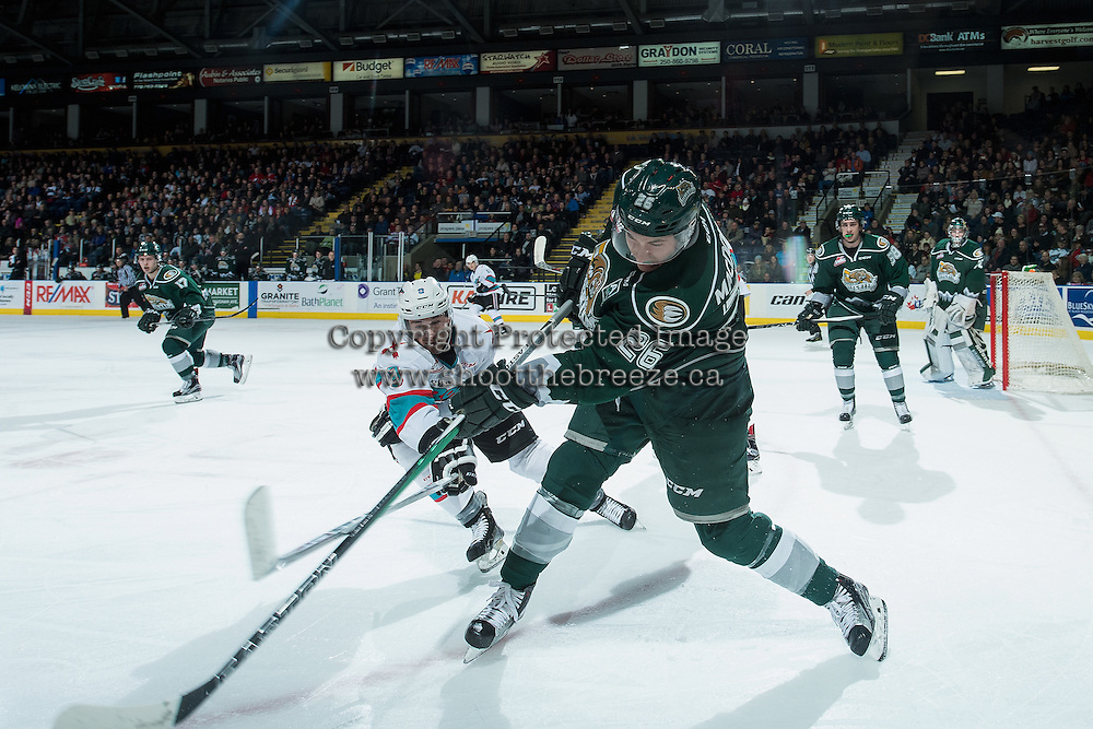 KELOWNA, CANADA - DECEMBER 30: Tanner Wishnowski #9 of Kelowna Rockets stick checks Cole MacDonald #26 of Everett Silvertips during first period on December 30, 2015 at Prospera Place in Kelowna, British Columbia, Canada.  (Photo by Marissa Baecker/Shoot the Breeze)  *** Local Caption *** Tanner Wishnowski; Cole MacDonald;