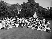 15/05/1959<br /> 05/15/1959<br /> 15 May 1959<br /> International Folk dancers at Wills tobacco factory. About sixty folk dancers from France, Denmark, India, Netherlands, Switzerland and Ireland, who were performing at the National Stadium, toured the W.D. & H.O. Wills factory at South Circular Road, Dublin. Afterwards they gave a performance in the factory garden. Picture shows the group in the garden with their Wills guides.