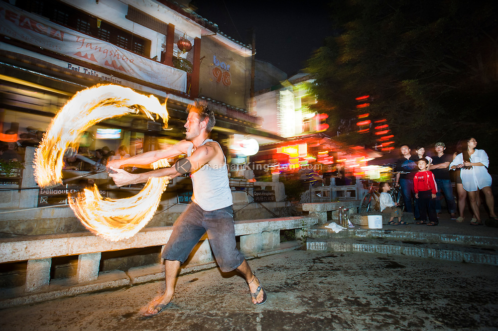 Liam Bolitho lights up the streets of Yangshuo, China after a day of climbing. (model released)