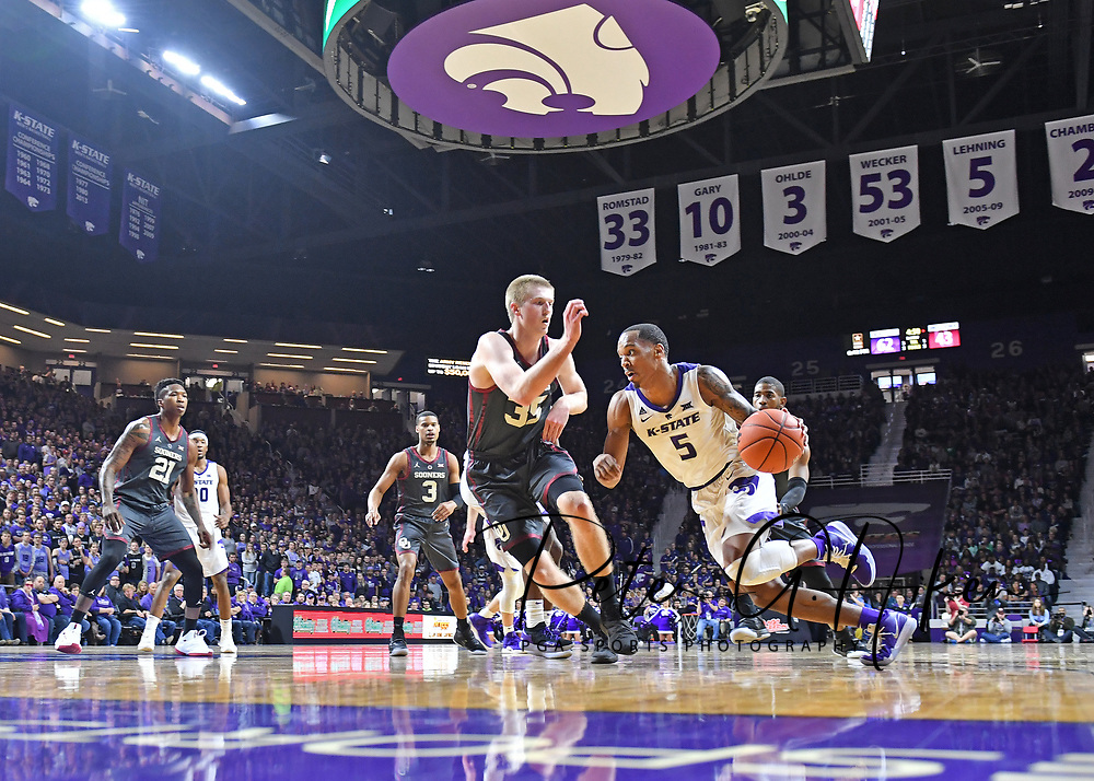 Barry Brown Jr. #5 of the Kansas State Wildcats drives to the basket against Brady Manek #35 of the Oklahoma Sooners during the second half at Bramlage Coliseum in Manhattan, Kansas.