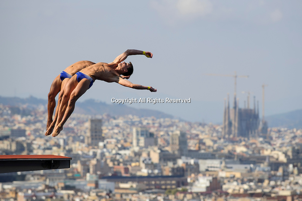 21.07.2013 Barcelona, Spain. Eventual Gold medallists Sascha Klein and Patrick Hausding of Germany (GER) in action during the Mens 10m Synchronised Platform Diving Final on Day 2 of the 2013 FINA World Championships, at the Piscina Municipal de Montjuic.