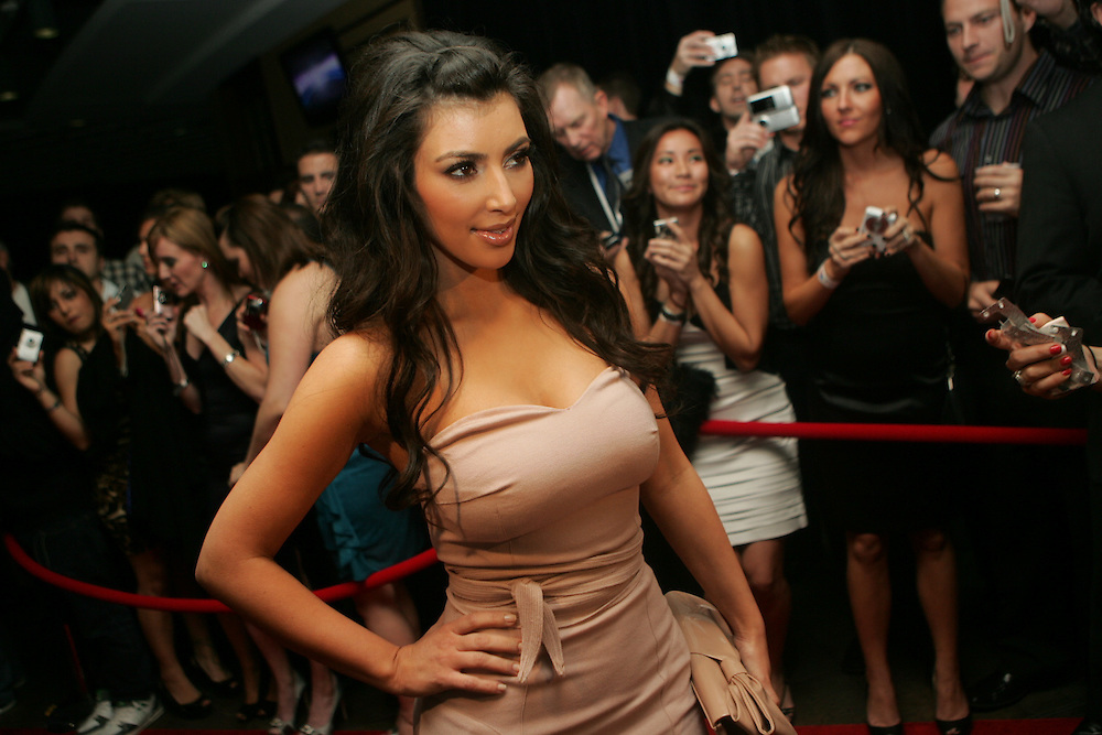 Kim Kardashian makes her entrance on the red carpet during the 6th Annual Leather & Laces party presented by Texas Energy Holdings held at Jackson's Bistro in Tampa.
