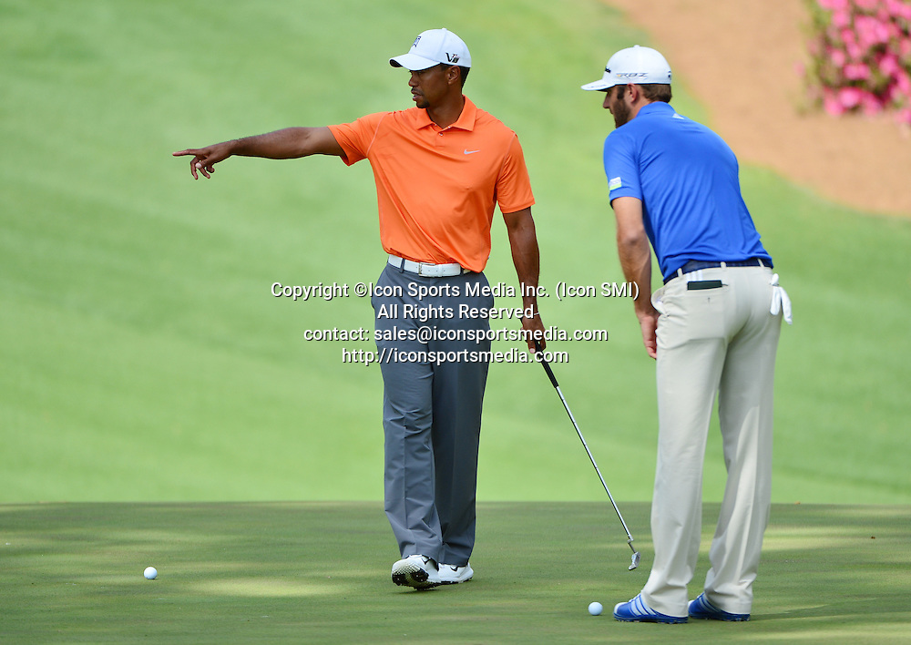 April 8, 2013 - Augusta, Georgia, U.S. - Tiger Woods, left, and Dustin Johnson putt on No. 10 during practice for the 2013 Masters Tournament at Augusta National Golf Club on Monday, April 8, 2013, in Augusta, Ga.