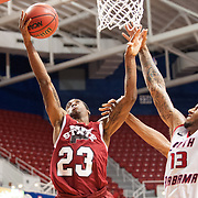 MOBILE, AL - DECEMBER 4:  Daniel Mullings #23 of the New Mexico State Aggies attempts a layup by Mychal Ammons #13 of the South Alabama Jaguars at USA Mitchell Center on December 4, 2012 in Mobile, Alabama. At halftime New Mexico State leads South Alabama 31-25. (Photo by Michael Chang/Getty Images) *** Local Caption *** Daniel Mullings;Mychal Ammons