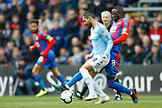 Crystal Palace midfielder Cheikhou Kouyate (8) tackles Manchester City midfielder Ilkay Gundogan (8) during the Premier League match between Crystal Palace and Manchester City at Selhurst Park, London, England on 14 April 2019.