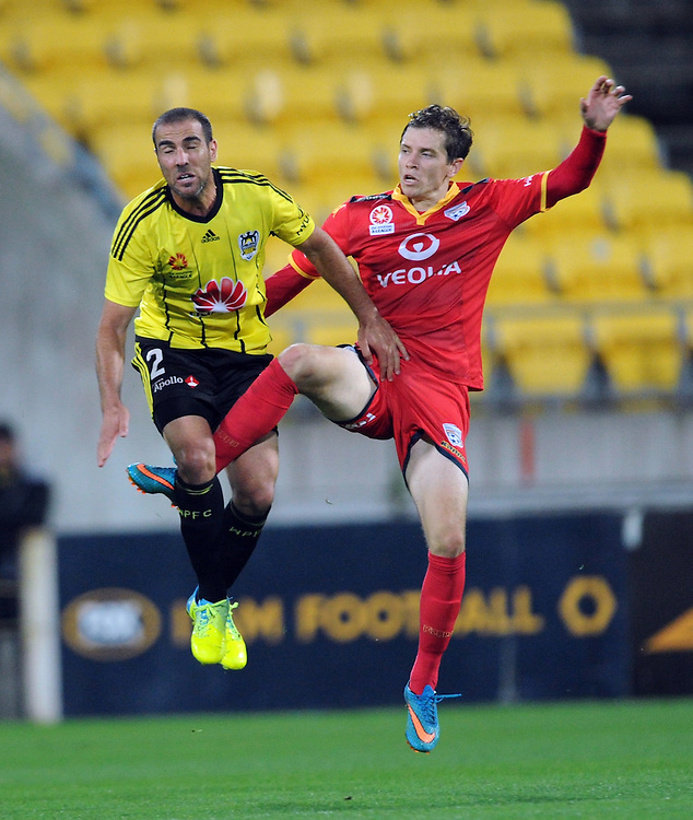 Phoenix's Manny Muscat, left and Adelaide United's Craig Goodwin tangle in the A-League football match at Westpac Stadium, Wellington, New Zealand, Saturday, March 05, 2016. Credit:SNPA / Ross Setford