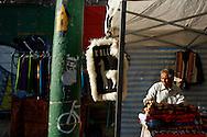 FEIRA DA KANTUTA - Sergio Quispe Cuellas, 75 anos, é imigrante no Brasil há 30, vindo da capital boliviana La Paz. Sérgio mora no Brás e mantém aos domingos sua barraca de malhas bolivianas na feira da praça Kantuka, no bairro Canindé, em São Paulo. Sérgio, que apesar da longa data de Brasil, diz que não fala mais o português porquê há alguns anos começou a desenvolver surdez e cegueira, o que o impede de ouvir e ler. Sergio mantém seu comércio na Kantuta há 20 anos, mas também administra sua pequena loja de roupas no Pari, região central de São Paulo. 26/06/2016