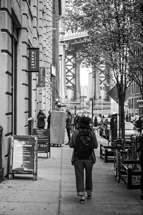 Woman walks on the streets of Brooklyn. Black and white.