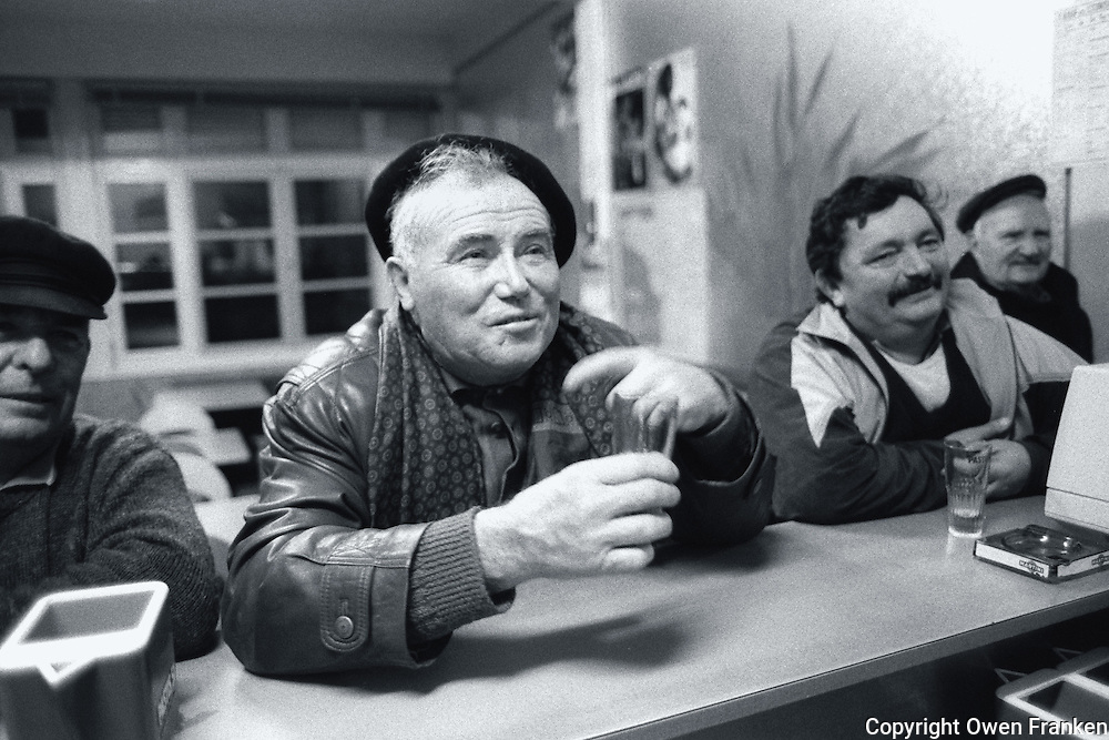 frenchmen at a bar- Photograph by Owen Franken